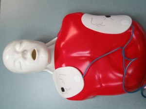 "AED Pads Place on CPR Mannequin used for CPR ""C"" Training"